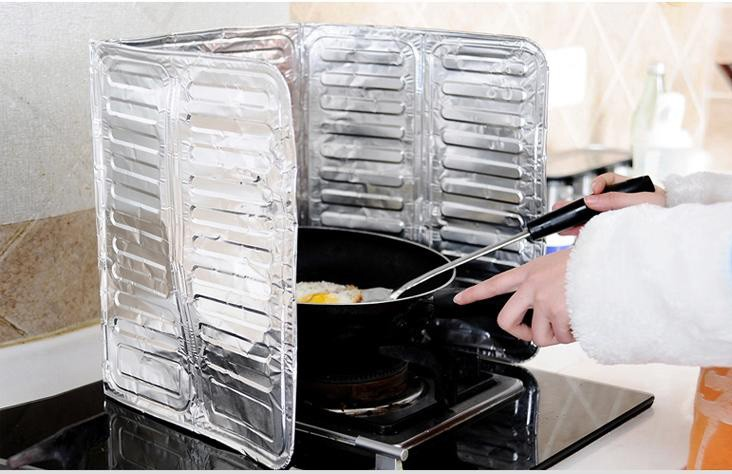 La cuisine résistant à l'huile des autocollants de cuisinière à gaz d'une feuille d'aluminium de haute résistance à la chaleur d'alu - tampon de retenue d'huile anti - plaque d'huile 65 g