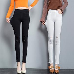 春夏季九分裤时尚修身流苏破洞毛边小脚裤高腰弹力女裤个性新风尚