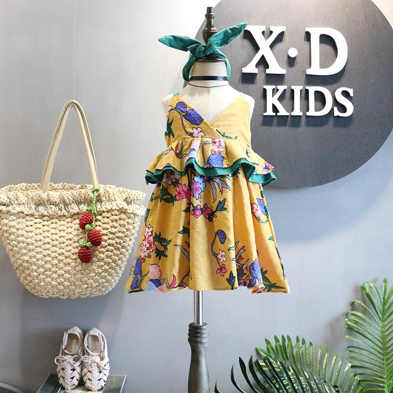 Trẻ em Hàn Quốc quần áo 2018 mùa hè mới cô gái retro đại dương kỳ nghỉ gió màu bông và vải lanh treo váy tóc ban nhạc