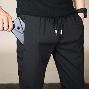 裤子男休闲裤春秋款男士运动裤春夏季男生韩版潮流黑色宽松直筒裤