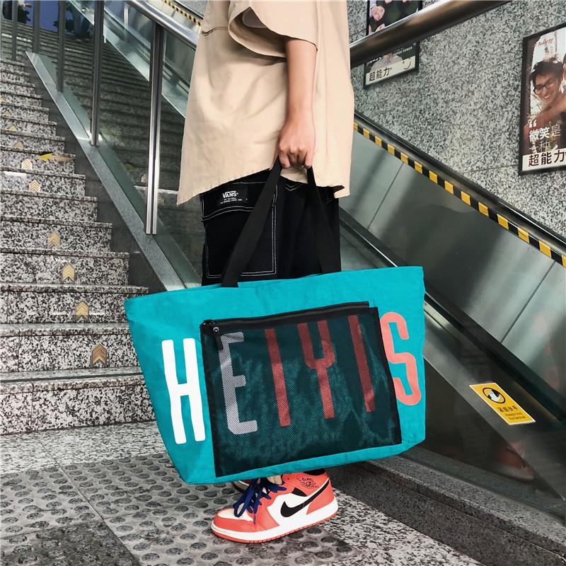 Túi du lịch nữ ngắn gọn di động công suất lớn gấp ánh sáng ra khô và ướt tách hành lý lưu trữ túi thể dục người đàn ông - Túi du lịch