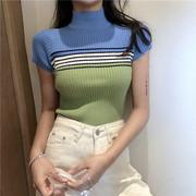 Mùa hè retro Hàn Quốc chic gió nhỏ đứng cổ áo ngắn màu xanh lá cây sọc rốn quần short áo len ngắn tay áo T-Shirt triều