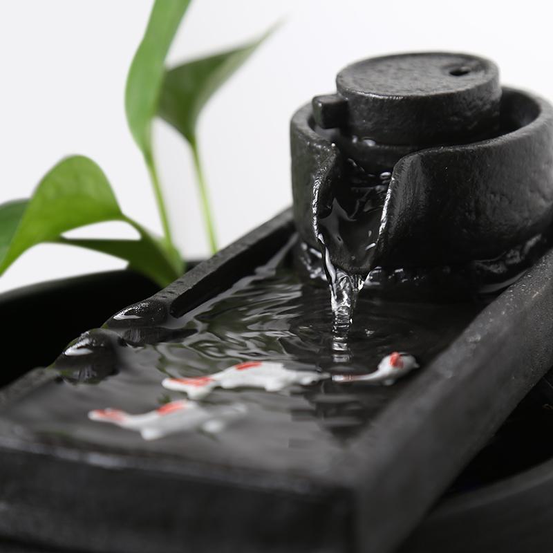 Mới của Trung Quốc gốm đồ trang trí nước bể cá văn phòng máy tính để bàn đài phun nước phòng khách gió bánh xe nước may mắn tạo độ ẩm zen