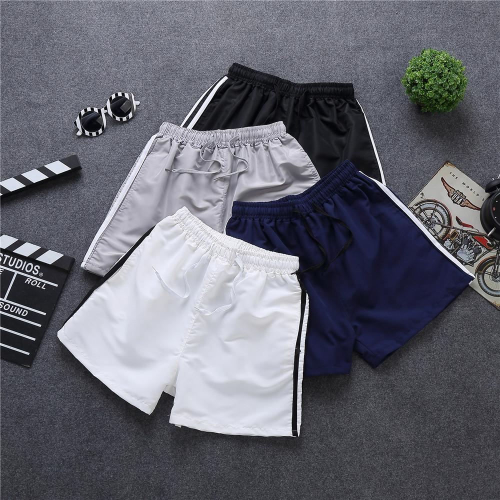 Mùa hè phần mỏng ba quần lỏng quần nóng bốn quần của nam giới kích thước lớn quần bó sát 3 điểm quần short bãi biển quần triều